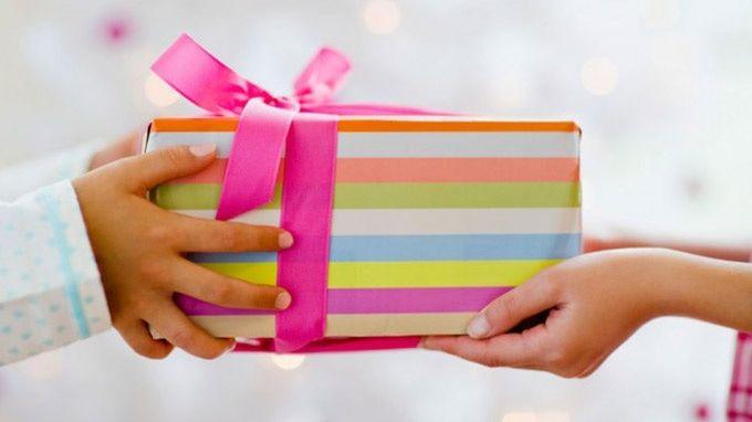 Christmas gift wrap relay