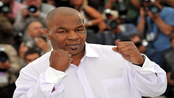 Famous Mike Tyson in white shirt