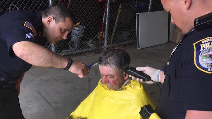 Image result for Police officers got some clothes and a haircut for a homeless person.