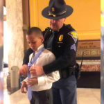 Kindhearted Cop Teaches A Young Boy How To Tie His Tie