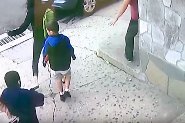 Woman Jumps In Front Of A Car To Save Little Boy's Life