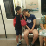 Little Boy Takes Care Of Exhausted Mom On Train In China